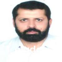 Best Dentist in Satyana Road, Faisalabad - Dr. Muhammad Farooq Azam